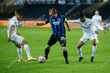 Brugge's Ruud Vormer, center, is challenged by Zenit's Douglas Santos, left, and Zenit's Wilmar Barrios, right, during a Champions league Group F soccer match between Brugge and Zenit at the Jan Breydel stadium in Bruges, Belgium