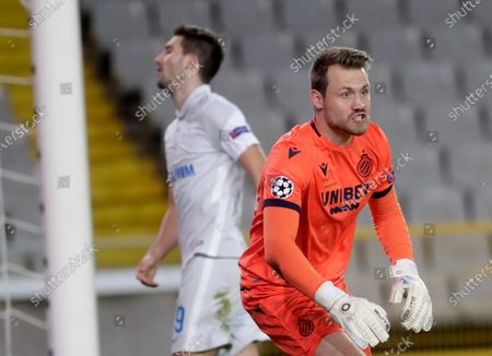 Brugge's goalkeeper Simon Mignolet (R) reacts during the UEFA Champions League group F soccer match between Club Brugge and Zenit St. Petersburg in Bruges, Belgium, 02 December 2020.