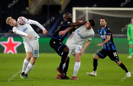 Brugge's Eder Balanta (2-L) in action against Zenit players Daniil Shamkin (L) and Leon Musaev (2-R) during the UEFA Champions League group F soccer match between Club Brugge and Zenit St. Petersburg in Bruges, Belgium, 02 December 2020.