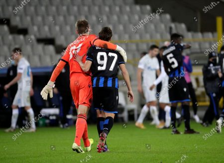 Brugge players Thomas Van Den Keybus (R) and goalkeeper Simon Mignolet (L) celebrate after the UEFA Champions League group F soccer match between Club Brugge and Zenit St. Petersburg in Bruges, Belgium, 02 December 2020.