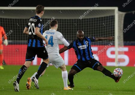 Brugge's Eder Balanta (R) in action against Zenit's Daler Kuzyaev (C) during the UEFA Champions League group F soccer match between Club Brugge and Zenit St. Petersburg in Bruges, Belgium, 02 December 2020.