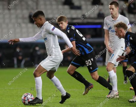 Zenit's Wilmar Barrios (L) in action against Brugge's Charles De Ketelaere (C) during the UEFA Champions League group F soccer match between Club Brugge and Zenit St. Petersburg in Bruges, Belgium, 02 December 2020.