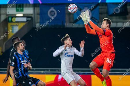 Zenit's Daler Kuzyaev and Club's goalkeeper Simon Mignolet fight for the ball during a soccer game between Belgian Club Brugge KV and Russian FC Zenit Saint Petersburg, Wednesday 02 December 2020 in Brugge, game four in the group stage of the UEFA Champions League, in group F.