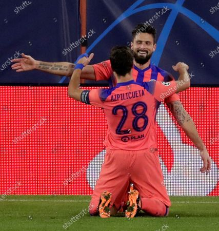 Chelsea's Oliver Giroud (back) celebrates with teammate Cesar Azpilicueta (front) after scoring the 2-0 lead during the UEFA Champions League group E soccer match between Sevilla FC and Chelsea FC at Ramon Sanchez Pizjuan stadium in Seville, Spain, 02 December 2020.
