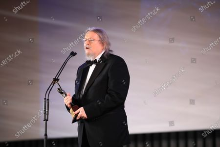 Screenwriter Sir Christopher Hampton speaks after receiving an award during the opening ceremony of the 42th Cairo International Film Festival (CIFF) in Cairo, Egypt, 02 December 2020. According to the organizers, the 42nd edition of the CIFF running from 02 to 10 December, will feature 16 titles on their international premieres in Cairo.