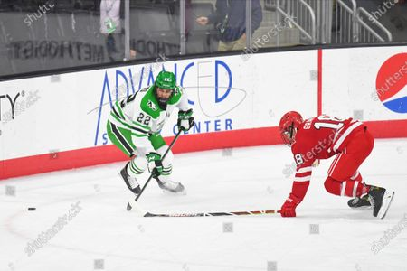 North Dakota Fighting Hawks forward Shane Pinto (22) and Miami RedHawks forward Monte Graham (18) chase after a loose puck during a NCAA D1 men's hockey game between the University of North Dakota Fighting Hawks and Miami University Redhawks at Baxter arena in Omaha NE, home of the NCHC ''Hub'' where the first 38 .National Collegiate Hockey Conference games are being played under secure conditions to protect from Covid-19. _ won_