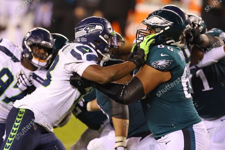 Seattle Seahawks' Carlos Dunlap (43) in action against Philadelphia Eagles' Jordan Mailata (68) during an NFL football game, in Philadelphia. The Seahawks defeated the Eagles