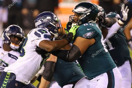 Stock Image of Seattle Seahawks' Carlos Dunlap (43) in action against Philadelphia Eagles' Jordan Mailata (68) during an NFL football game, in Philadelphia. The Seahawks defeated the Eagles