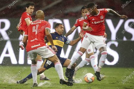 Stock Picture of Carlos Tevez of Argentina's Boca Juniors is surrounded by players of Brazil's Internacional during a Copa Libertadores round of sixteen first leg soccer match at the Beira-Rio stadium in Porto Alegre, Brazil