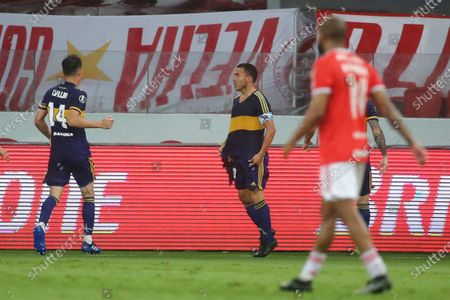 Carlos Tevez of Argentina's Boca Juniors, right, celebrates scoring his side's opening goal against Brazil's Internacional during a Copa Libertadores round of sixteen first leg soccer match at the Beira-Rio stadium in Porto Alegre, Brazil