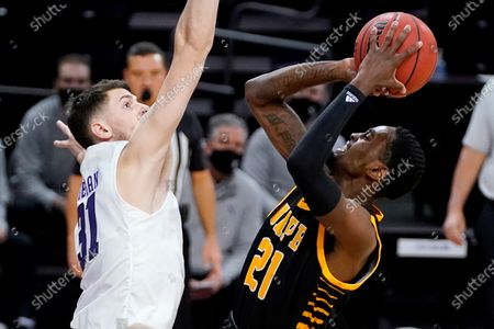 Arkansas-Pine Bluff guard Shaun Doss Jr., right, shoots against Northwestern forward Robbie Beran during the first half of an NCAA college basketball game in Evanston, Ill