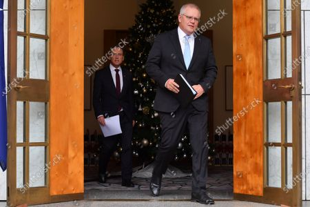 Minister for Health Greg Hunt (L) and Australian Prime Minister Scott Morrison (R) arrive at a press conference at Parliament House in Canberra, Australia, 03 December 2020. Australian Prime minister Scott Morrison discussed details of the roll-out of the COVID-19 vaccine in Australia.
