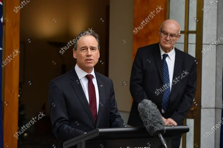 Minister for Health Greg Hunt (L) and Therapeutic Goods Administration (TGA) head Professor John Skerritt (R) speak to the media during a press conference at Parliament House in Canberra, Australia, 03 December 2020. Australian Prime minister Scott Morrison discussed details of the roll-out of the COVID-19 vaccine in Australia.