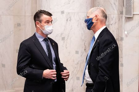 U.S. Senator Todd Young (R-IN) and U.S. Senator Rick Scott (R-FL) speaking at a meeting of the Senate Commerce, Science, and Transportation Committee.