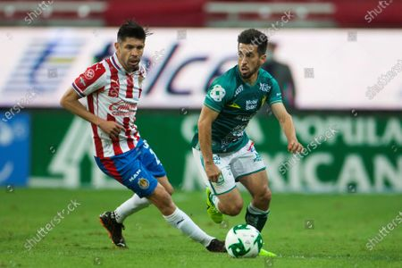Stock Picture of Oribe Peralta (L) of Guadalajara in action against Fernando Navarro (R) of Leon during the first leg of the Apertura Tournament semifinals between Guadalajara and Leon at the Akron Stadium in Zapopan, Jalisco state, Mexico, 02 December 2020.