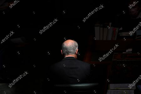 Australian Prime Minister Scott Morrison sits in a shaft of sunlight during House of Representatives Question Time at Parliament House in Canberra, Australia, 03 December 2020.
