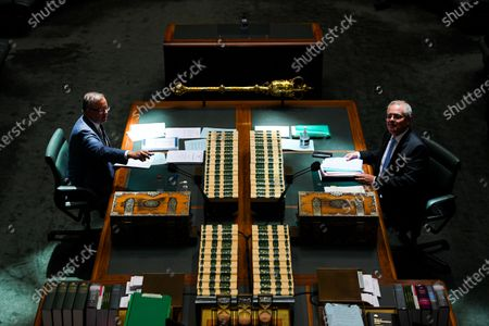Australian Prime Minister Scott Morrison (R) and Australian Opposition Leader Anthony Albanese (L) sit in a shaft of sunlight during House of Representatives Question Time at Parliament House in Canberra, Australia, 03 December 2020.