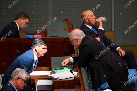 Australian Prime Minister Scott Morrison (R) speaks to Australian Energy Minister Angus Taylor (L) during House of Representatives Question Time at Parliament House in Canberra, Australia, 03 December 2020.