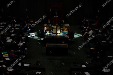 Australian Prime Minister Scott Morrison (L) and Australian Opposition Leader Anthony Albanese sit in a shaft of sunlight during House of Representatives Question Time at Parliament House in Canberra, Australia, 03 December 2020.