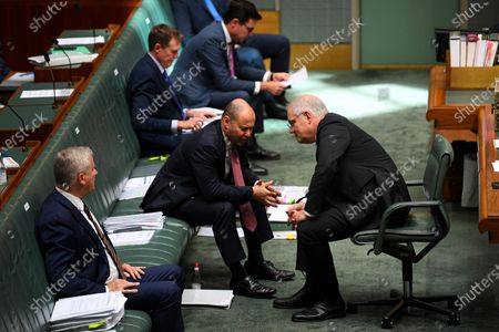 Australian Prime Minister Scott Morrison  (R) speaks to Australian Treasurer Josh Frydenberg (L) during House of Representatives Question Time at Parliament House in Canberra, Australia, 03 December 2020.