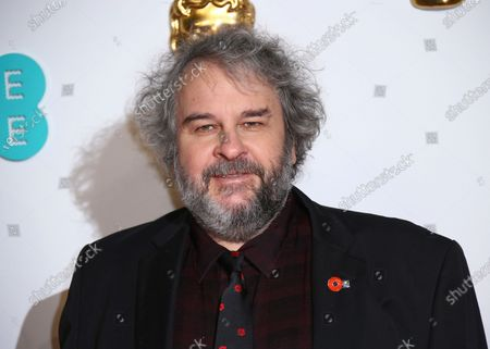 Peter Jackson poses for photographers at the BAFTA awards in London. Jackson's company, Weta Digital, one of the world's premier visual effects companies, will begin producing original content. Tech billionaire Sean Parker has been approved by New Zealand authorities to buy a one-third stake in Jackson's visual effects studio