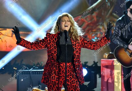 Stock Photo of Singer Tori Kelly performs at the 88th annual Rockefeller Christmas Tree Lighting in New York City.