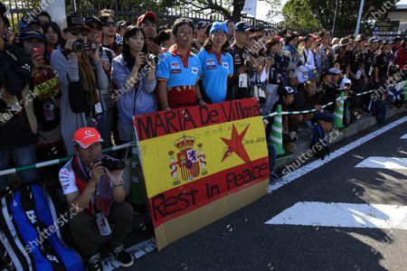 Suzuka Circuit, Suzuka, Japan.  Sunday 13th October 2013.  Fans hold a sign for the late Maria De Villota. World Copyright: Charles Coates/LAT Photographic