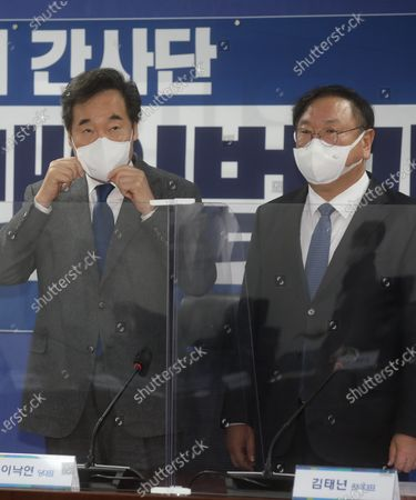 Lee Nak-yon (L), leader of the ruling Democratic Party, and Kim Tae-nyeon, the party's floor leader, attend a party meeting at the National Assembly in Seoul, South Korea, 03 December 2020.