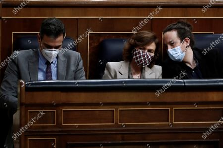 (L-R) Spanish Prime Minister, Pedro Sanchez, his First Deputy PM, Carmen Calvo, and Second Deputy PM, Pablo Iglesias, attend a debate on 2021 National Budget bill at Congress of Deputies in Madrid, Spain, 03 December 2020. It is expected the National Budget bill will be passed with an absolute majority at Lower Chamber after the agreements reached by central government with several other political parties.