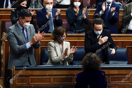 Spanish Prime Minister, Pedro Sanchez (L), his First Deputy PM, Carmen Calvo (2-L), and Second Deputy PM, Pablo Iglesias (R), applaud Treasure Minister, Maria Jesus Montero (R, front) during a debate on 2021 National Budget bill at Congress of Deputies in Madrid, Spain, 03 December 2020. National Budget bill was passed at Lower Chamber after the agreements reached by central government with several other political parties.