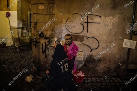 The street artist Tvboy at work in the night, the artwork 'Giggiebbasta' depicts the Italian Minister of Foreign Affairs Luigi Di Maio as the Italian rapper Sfera e Ebbasta