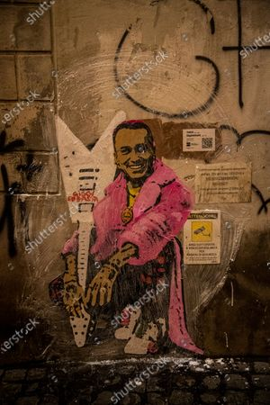 Stock Photo of The street artist Tvboy at work in the night, the artwork 'Giggiebbasta' depicts the Italian Minister of Foreign Affairs Luigi Di Maio as the Italian rapper Sfera e Ebbasta