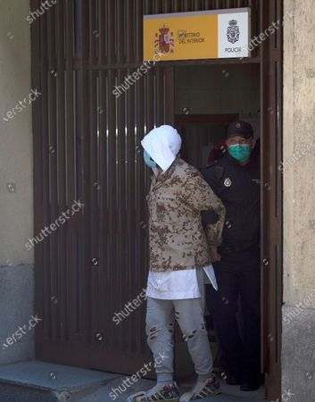 Stock Photo of Flamenco dancer Rafael Amargo (C) is escorted by a policeman (R) to a police van in his way to appear before the court as suspect in a drug-trafficking case, in Madrid, Spain, 03 December 2020. Rafael Amargo was arrested last 01 December during a rehearsal of his lastest show at La Latina Theater in Madrid, together with his romantic partner and his producer after several raids were carried out in several Amargo's properties where it were found 60 grams of meth, 20 grams of ketamine and 6,000 euro cash, according to investigation sources.