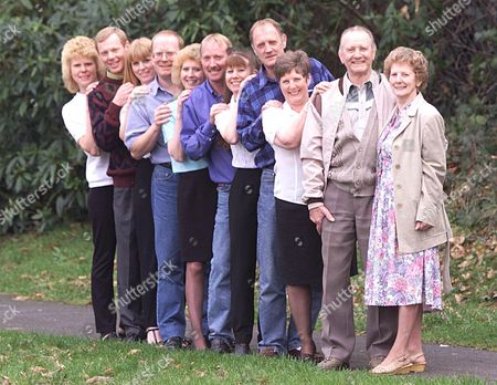 Stock Picture of Mr.and Mrs Edward (78) And Betty (72) Smith And Their Nine Children ( Born Boy Girl Boy Girl) From Lovedean Hampshire Left To Right In Age Order Linda Barnes (34) Robin Smith(38) Carole Bennett (38).roy Chowns-smith (41) Valerie Jafkins(42) David Smith(45) Joan Oates(47) John Smith (49)and Rosemary Iles (42).the Odds Against Such A Sequence Of Births In A Family Are 20 Million To One.
