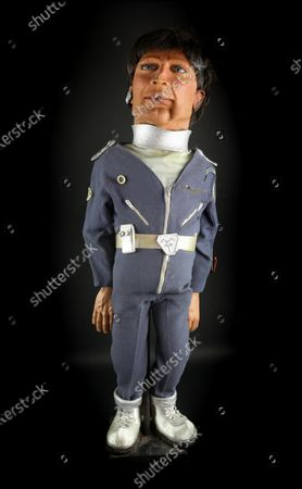 An 80cm tall Dr. Tiger Ninestein puppet, used in the production of Terrahawks, with original latex face and full costume used in various scenes on the series sold for £2340   A huge hidden cache of Thunderbirds creator Gerry Anderson's production puppets, props and scripts have sold for £203,000.  They had belonged to the late John Bell, a driver and handyman at Bray Studios in Berkshire where the special effects for Anderson's shows were filmed. He was given hundreds of mementos by a senior director at Anderson's production company as they had no storage facilities for them.  The archive was uncovered following Mr Bell's death last year and went under the hammer with auctioneers Ewbank's, of Woking, Surrey. The sale sparked worldwide interest as it was feared many of these treasured items had ended up in a skip.