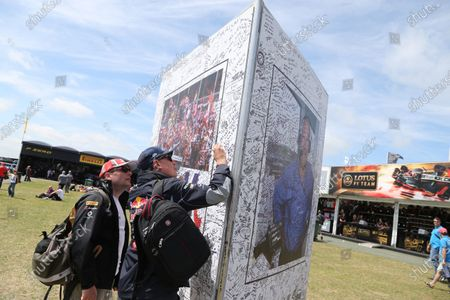 Silverstone, Northamptonshire, England 30th June 2013 Fans sign a giant card dedicated to Murray Walker. World Copyright: Jakob Ebrey/LAT Photographic.