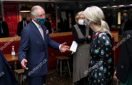Prince Charles wears a face mask as he speaks to Deputy Mayor for Culture Justine Simons during his visit to Soho Theatre with Camilla Duchess of Cornwall to celebrate London's night economy.