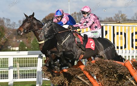 (R) Elham Valley (Paddy Brennan) takes the last before going on to win The Betfair Free Bet On The 1.50 Introductory Juvenile Hurdle Race from (L) Hudson De Grugy (Joshua Moore). Photo G Hugh Routledge.