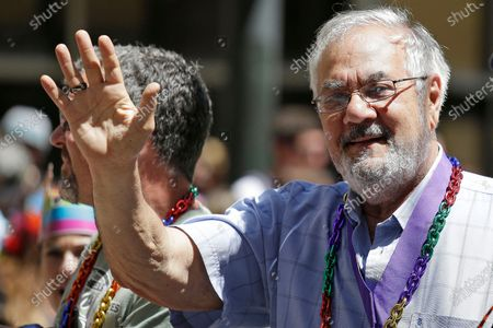 Former Massachusetts congressman Barney Frank, right, waves while riding with his husband James Ready, left, during the 44th annual San Francisco Gay Pride parade in San Francisco. Frank and Ready filed a lawsuit, against a construction contractor who they said abandoned the building of their home in Maine in May after only completing part of the agreed upon work