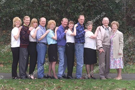 Editorial photo of Mr.and Mrs Edward (78) And Betty (72) Smith And Their Nine Children ( Born Boy Girl Boy Girl) From Lovedean Hampshire Left To Right In Age Order Linda Barnes (34) Robin Smith(38) Carole Bennett (38).roy Chowns-smith (41) Valerie Jafkins(42) David Smi