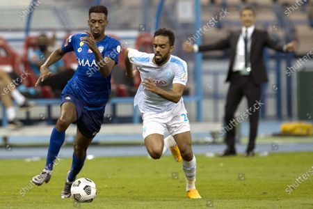 Al-Hilal's player Mohamed Kanno (L) in action against Al-Fateh's Ali Al-Zaqan (R) during the Saudi Professional League soccer match between Al-Hilal and Al-Fateh at King Fahd International Stadium, in Riyadh, Saudi Arabia, 03 December 2020.