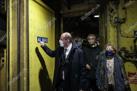 Prime Minister Jean Castex, accompanied by the mayor of Calais Natacha Bouchart, the president of Getlink Jacques Gounon visit the interior of a tunnel at Eurotunnel Le Shuttle, the piggyback service operated by Eurotunnel in the channel tunnel.