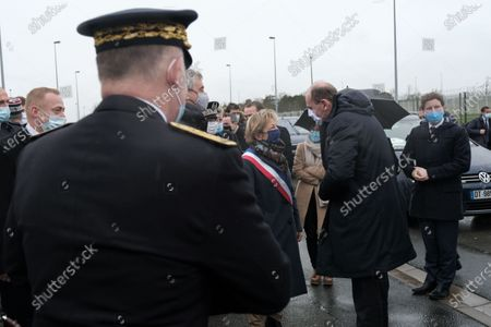 Prime Minister Jean Castex arrives at the Eurotunnel site in Calais. He greets Natacha Bouchart, the mayor of Calais and Jacques Gounon, the president of Getlink.