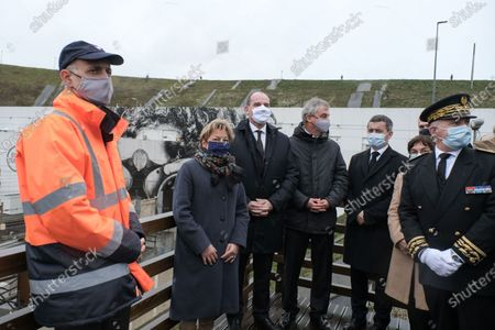 Prime Minister Jean Castex, accompanied by the Mayor of Calais Natacha Bouchart, the President of Getlink Jacques Gounon, and the Minister of the Interior Gerald Darmanin at Eurotunnel Le Shuttle, the piggyback service operated by Eurotunnel in the Channel Tunnel.