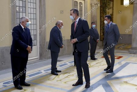 Spain's King Felipe VI (2-L) accompanied by Spanish Prime Minister Pedro Sanchez (R), arrives to attend a meeting with the Carolina Foundation in Madrid, Spain, 03 December 2020.