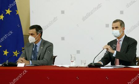 Spain's King Felipe VI (R) accompanied by Spanish Prime Minister Pedro Sanchez, chairs a meeting with the Carolina Foundation in Madrid, Spain, 03 December 2020.