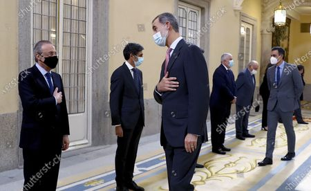 Stock Photo of Spain's King Felipe VI (2-L) accompanied by Spanish Prime Minister Pedro Sanchez (R), greets ACS president Florentino Perez (L) before a meeting with the Carolina Foundation in Madrid, Spain, 03 December 2020.