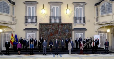 Spain's King Felipe VI (C) accompanied by Spanish Prime Minister Pedro Sanchez (C-L), poses for a group photo at a meeting with the Carolina Foundation in Madrid, Spain, 03 December 2020.