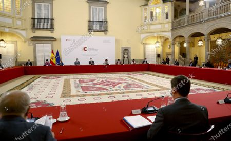 Spain's King Felipe VI (C) accompanied by Spanish Prime Minister Pedro Sanchez (C-L), chairs a meeting with the Carolina Foundation in Madrid, Spain, 03 December 2020.