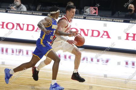 Stock Picture of Ohio State forward Kyle Young, right, drives against Morehead State forward Julius Dixon during an NCAA college basketball game in Columbus, Ohio, . Ohio State won 77-44